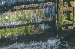 Small waterfall in countryside - vintage film look. Small waterfall in countryside. nature in latvia - vintage film look Stock Photo