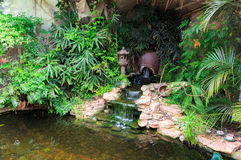 Small waterfall in decorative pond Stock Images