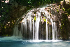Small waterfall in deep forest Royalty Free Stock Image