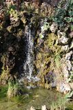 Small waterfall falling on stones royalty free stock photography