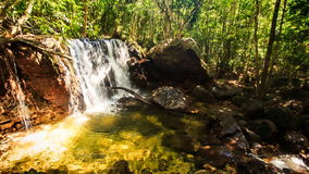 Small Waterfall Falls into Transparent Pond in Tropical Forest stock footage