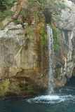 Small waterfall on the Sorrento coastline. A small waterfall flowing into the ocean around Sorrento royalty free stock image