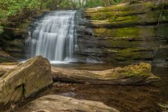Small waterfall in a forest royalty free stock photo