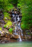 Small waterfall in forest. Lovely summer nature scenery. fresh and clean environment. Located in Synevyr National park, Ukraine Stock Images