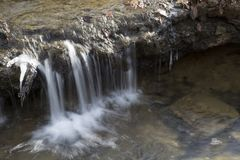 Small waterfall in forest stream stock photo