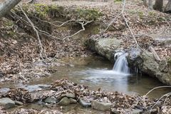 Small waterfall in forest stream royalty free stock photos