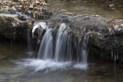 Small waterfall in forest stream royalty free stock photography