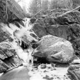 Small waterfall on a frosty winter day - shot with analogue film. Small waterfall on a frosty winter day in Uddevalla, Sweden. Image is taken with a full-frame stock images