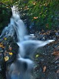 Small waterfall full of water after rain.   Stock Photography