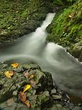 Small waterfall full of water after rain.   Royalty Free Stock Image