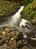 Small waterfall full of water after rain.   Royalty Free Stock Photos