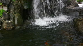 Small waterfall in garden stock video footage