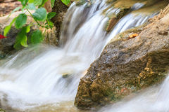 Small waterfall in a garden Royalty Free Stock Photos