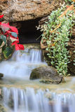 Small waterfall in a garden Stock Photo
