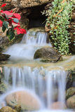 Small waterfall in a garden Stock Image