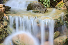 Small waterfall in a garden Stock Images