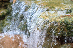 Small waterfall in a garden Royalty Free Stock Image