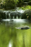 Small waterfall and green reflections in Hebron, Connecticut. Stock Photography