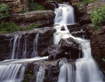 Small Waterfall (H). A small waterfall along the Going to the Sun Road in Montana's Glacier National Park stock photo