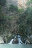 A small waterfall on a hillside stock photography