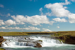 Small waterfall in Iceland. With Hella Volcano in the back Stock Photography