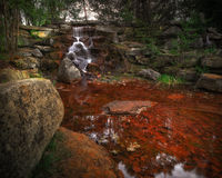 Free Small Waterfall In Stone Grotto Royalty Free Stock Images - 30906919