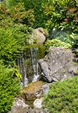 Small waterfall in the Japanese garden Royalty Free Stock Images