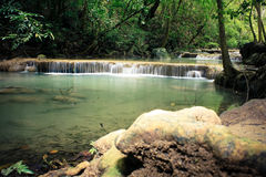 A small waterfall in the jungle. Small waterfall in the wild jungle stock photos