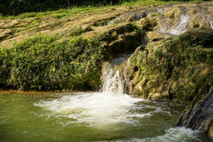 Small Waterfall by the Lake Royalty Free Stock Image