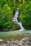 Small waterfall on a little mountain stream Stock Photos