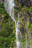 A small waterfall at Milford Sound Royalty Free Stock Images