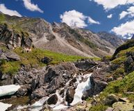Small waterfall on a mountain creek Royalty Free Stock Photos