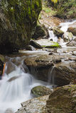Small waterfall on a mountain rive. R between rocks royalty free stock photography