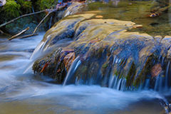Small waterfall on mountain river Stock Images