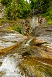 Small waterfall on a mountain river Stock Images
