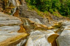Small waterfall on a mountain river Stock Photography