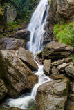 Small waterfall on a mountain river. Small waterfall on a mountain stony river stock photo