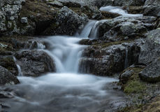 Small waterfall on mountain river Zagedanka. Stock Photography