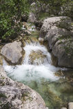 Small waterfall on mountain stream Stock Photography