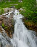 Small waterfall in a mountains Royalty Free Stock Photos