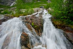 Small waterfall in a mountains Royalty Free Stock Image