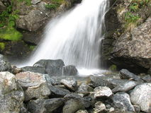 Small waterfall on norwegian river Stock Photos