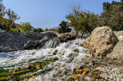 Small waterfall and old arch on a background in Preveli, Crete island Royalty Free Stock Image
