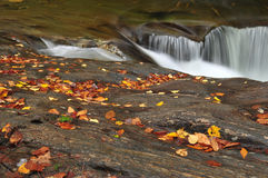 A small waterfall over smooth rocks Royalty Free Stock Image