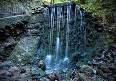 A small waterfall in the park.  Royalty Free Stock Photos