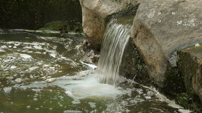 Small waterfall in the park stock video footage