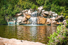 Small waterfall in the park stock images