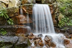 Small waterfall in a park in Germany Stock Images