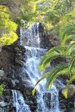 Small waterfall in the park in Loutraki. Royalty Free Stock Image