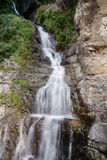 Small waterfall with plants and rocks in Rize, Turkey.  Royalty Free Stock Photo